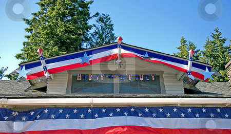 House Roof Decorated 4th Of July stock photo, This house roof is decorated with red, white and blue for 4th Of July celebration. by Valerie Garner