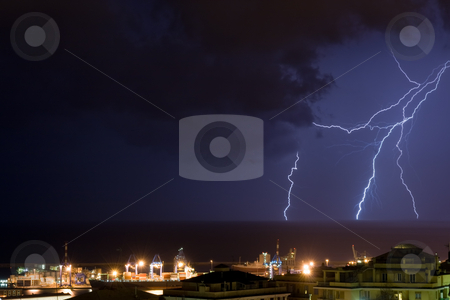 Lightning in Genova stock photo, Lightning into the sea near the port of Genova, Italy during a violent storm by ANTONIO SCARPI