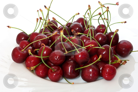 Group of cherries stock photo, A group of ripe cherries on o white plate by ANTONIO SCARPI