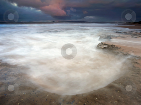 Storm Bowl stock photo, A break in morning storm allowed a bit of sunrise color as the tides flood a bowl like depression in the limestone along the beach at Encounter Bay. by Mike Dawson
