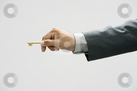Man using a key stock photo, Man showing a key with  the white background by eskaylim
