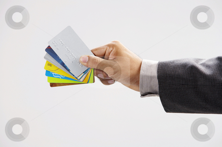 Man showing few credit cards  stock photo, Man showing few credit cards with white background by eskaylim