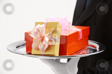 Man holding exclusive presents  stock photo, Man holding exclusive presents to someone special by eskaylim