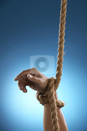 Hang tight by rope stock photo, Hand being tight by rope asking for help by eskaylim