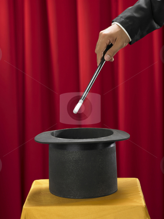 Stick and top hat stock photo, Magician with the stick in front of top hat by eskaylim