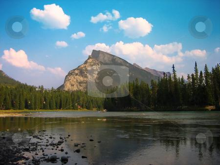 Banff, Alberta stock photo, Reflection of a mountain caught in Banff, Alberta, Canada by Bernard Cruz