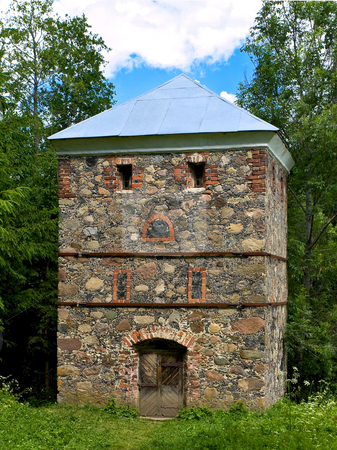 Tower  stock photo, Old stone tower in the forest by Sergej Razvodovskij