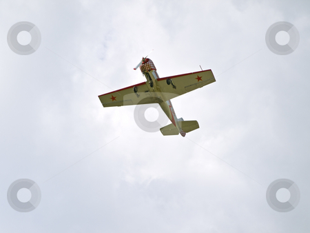 Aeroplane  stock photo, Single sport aeroplane flying in the blue sky by Sergej Razvodovskij