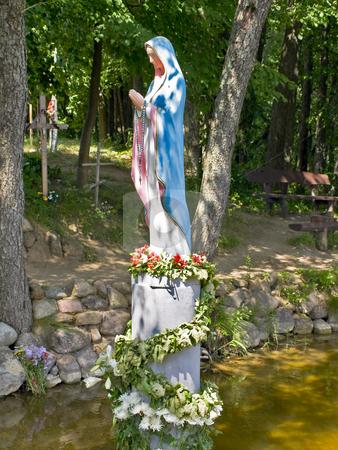 Figure  stock photo, Virgin Mary figure in the water by Sergej Razvodovskij