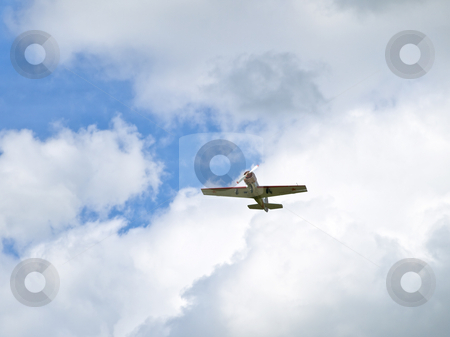 Aeroplane  stock photo, Little aircraft flying through white clouds by Sergej Razvodovskij