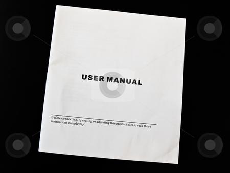 Manual  stock photo, User manual guide brochure against the black background by Sergej Razvodovskij