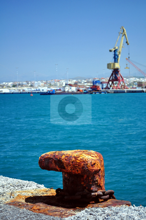 Rusty cleat stock photo, Travel photography: Old rusty cleat in the Mediterranean port of Heraklion,   Crete, Greece by Fernando Barozza