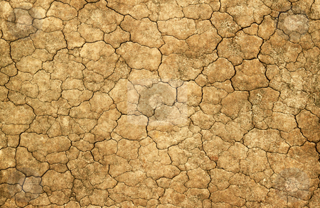 Dry cracked mud natural abstract background. stock photo, Dry cracked mud natural abstract background. by Stephen Rees