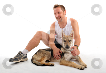 After sport training stock photo, Portrait of a man resting after sport training with his puppy by Bonzami Emmanuelle