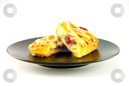 Raspberry Danish on a Black Plate stock photo, Raspberry and custard danish on a black plate on a white background by Keith Wilson