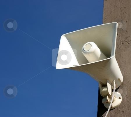 Speaker Megaphone stock photo, Speaker megaphone white on pole with blue sky in background by Henrik Lehnerer