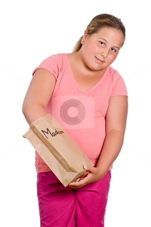 School Lunch stock photo, A preteen girl reaching into her lunch bag to get her food out, isolated against a white background - artificial name on the lunchbag by Richard Nelson