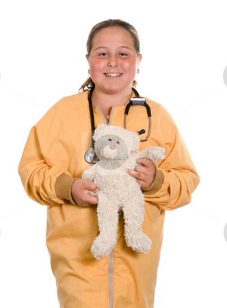 Child Nurse stock photo, A young girl pretending to be a nurse and holding a stuffed bear, isolated against a white background by Richard Nelson
