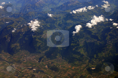 Aerial view of the Alps in summer stock photo, Aerial view of the Swiss alps and fertile valley in summer by Stephen Goodwin