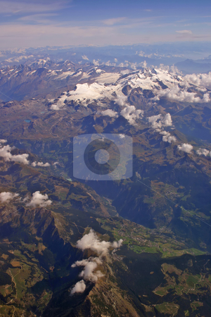 Aerial view of the Alps in summer vertical stock photo, Aerial view of the Swiss alps in summer with clouds and blue sky vertical by Stephen Goodwin