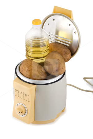 French fries machine stock photo, Fry potatoes prepared in french fries machine isolated on white background by Vladyslav Danilin