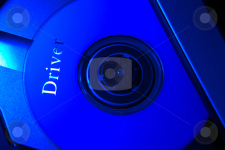 Laptop with a Data disk CD  stock photo, Laptop with a Data disk CD ,In  blue tone. by Vladyslav Danilin