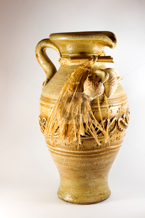 Pottery pitcher antique stock photo, Pottery pitcher antique ,in brown background. by Vladyslav Danilin