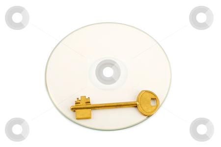 Golden key on compact disk stock photo, Golden key on compact disk isolated on white background by Vladyslav Danilin