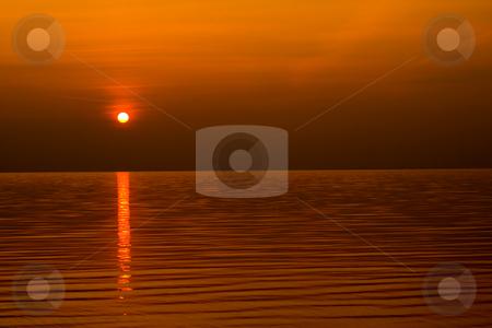 Sundown scene  stock photo, Sundown scene with dark clouds and rays over sea. background, wallpaper. by Vladyslav Danilin