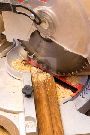 Electric Saw stock photo, Electric saw cuts plank a plinth under corner 45 degrees. by Vladyslav Danilin