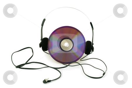 Headphones stock photo, Headphones in disk computer by Vladyslav Danilin