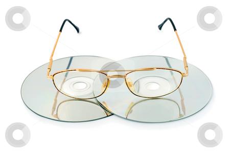 Glasses in cd disk stock photo, Glasses in cd disk by Vladyslav Danilin