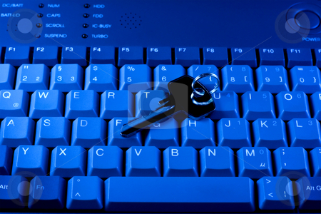Computer keyboard and key stock photo, Key rests upon computer keyboard , blue background by Vladyslav Danilin