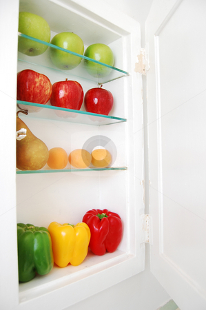 Fruit and Veggie Prescription stock photo, Colorful fruit and veggies on the shelves of a medicine cabinet. by Tina Kim