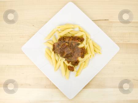 Mostacolli with spaghetti sauce stock photo, Mostacolli with spaghetti sauce on a white plate by John Teeter