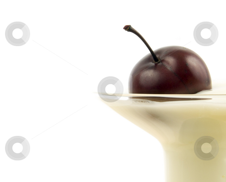 Close up of cherry in yogurt  stock photo, Close up of Cherry in Yogurt on white background by John Teeter