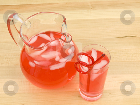 Juice in Glass and Pitcher stock photo, Juice in Glass and Pitcher on wooden background by John Teeter