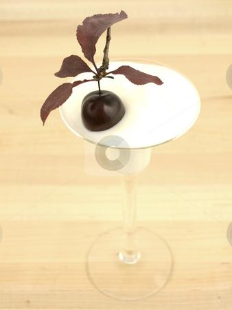 Cherry in Yogurt stock photo, Cherry in yogurt on a wooden background by John Teeter