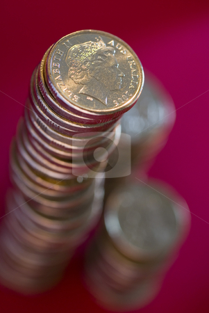 Stack of australian dollar coins stock photo, A large stack of australian dollar coins on a red background by Stephen Gibson