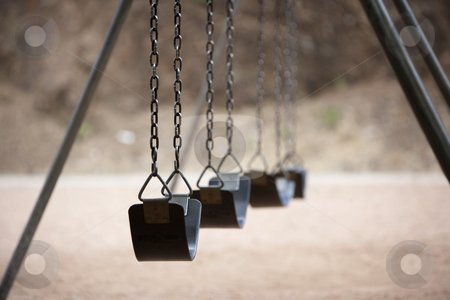 Playground Swings stock photo, Old style playground swings with chains and rubber seats by Scott Griessel