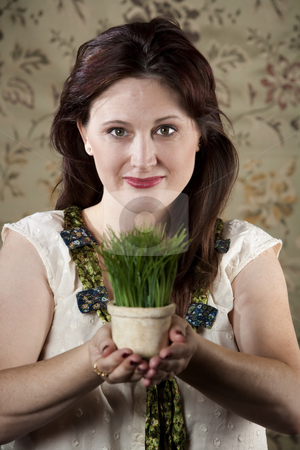 Woman with Small Pot of Green Grass stock photo, Pretty woman with small pot of bright green grass by Scott Griessel