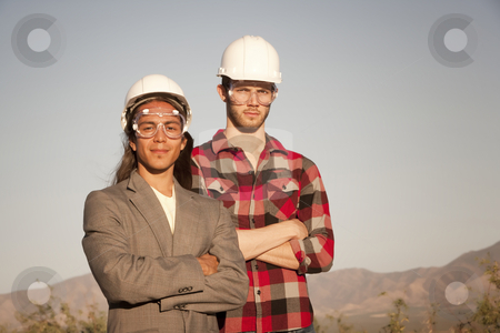 Men in hardhats stock photo, Two handsome men outdoors wearing protective hardhats by Scott Griessel