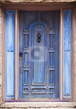 Old Blue Door stock photo, Old peeling blue door with metal knocker by Scott Griessel