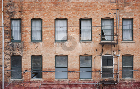 Many windows on old building stock photo, Many windows on a brick building from the 1800s in Bisbee Arizona by Scott Griessel