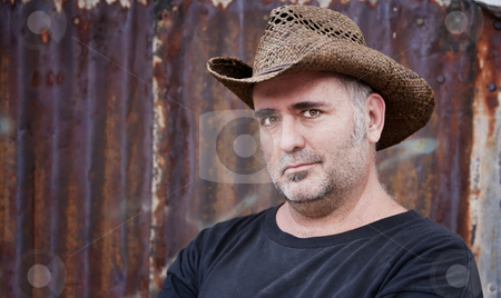 Man in Cowboy Hat stock photo, Mature man with gray stubble in a cowboy hat by Scott Griessel