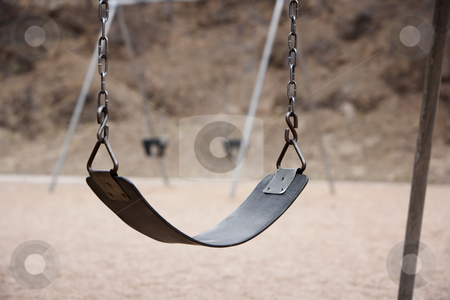 Playground Swings stock photo, Old style playground swing with chains and rubber seat by Scott Griessel