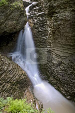 Waterfalls on a mountain river stock photo, small cascade of waterfalls on a mountain river by Valery Kraynov