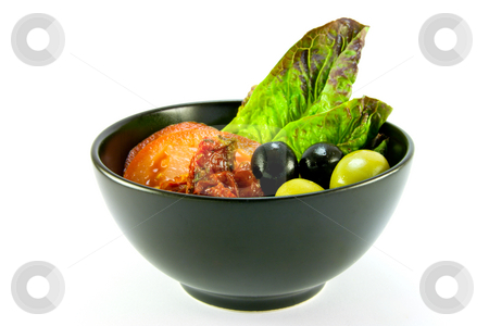 Salad Bowl stock photo, Black bowl with tomatoes, lettace and green and black olives on a white background by Keith Wilson