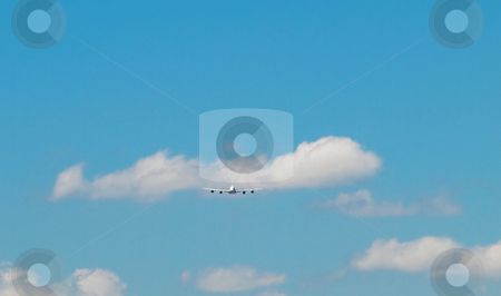 Jumbo airliner stock photo, Aircraft  doing a landing approach under blue sky with clouds by Laurent Dambies