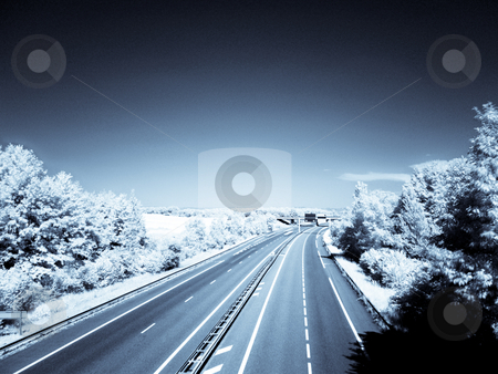 Infrared highway stock photo, Infrared picture of an empty highway with blue sky by Laurent Dambies